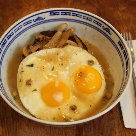 vegetarian loco moco recipe with fork and knife on side.