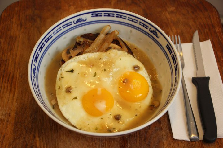 vegetarian loco moco recipe with fork and knife on side