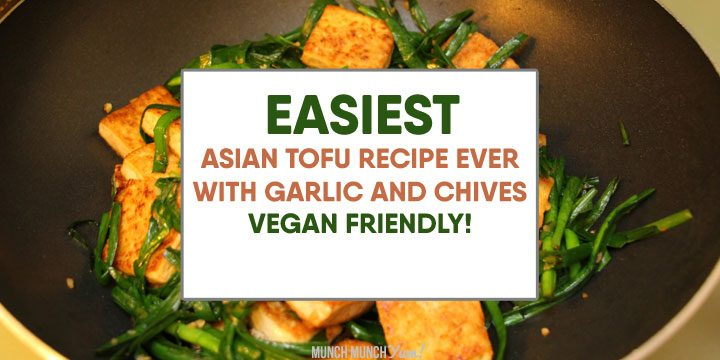 easy asian tofu recipe with garlic and chives, vegan friendly atop fried tofu and veggies in a wok