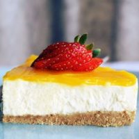 simple, easy no bake cheesecake with mango and strawberry for recipe card.