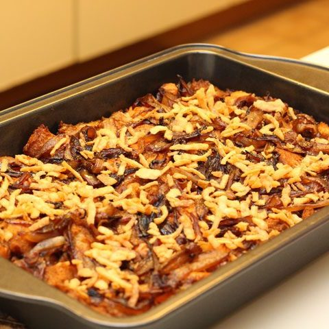 easy homemade french onion thanksgiving stuffing in baking pan oven.