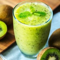 top view of kiwi smoothie with sliced kiwi fruit for recipe card.