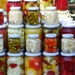jars of pickled foods like okra, cauliflower, garlic, peppers, onions and more