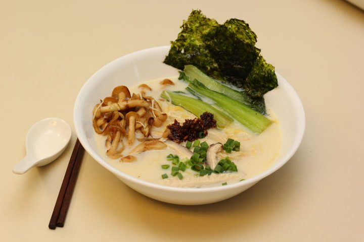 vegan tonkotsu soy milk ramen with chopsticks and soup spoon.