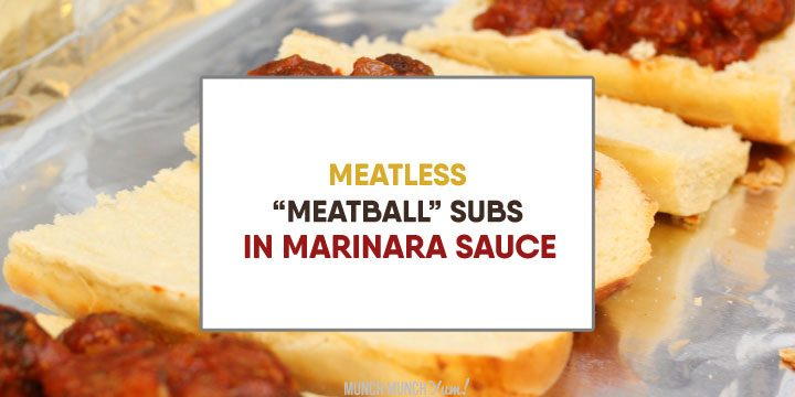 meatless meatball subs dipped in marinara atop sandwiches laid out ready to go into oven