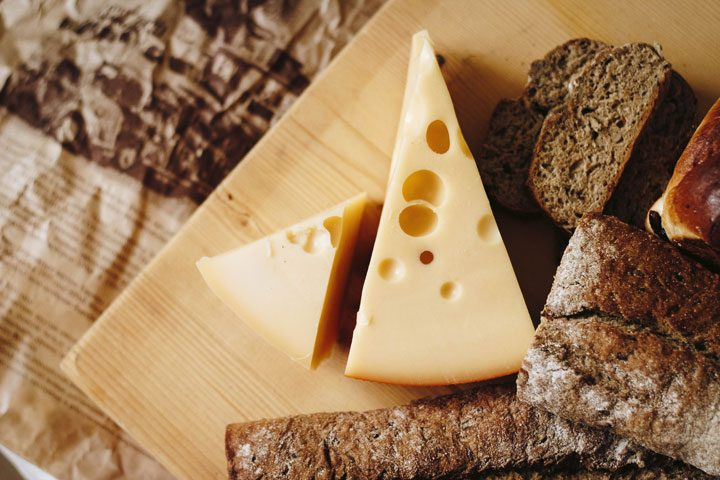 triangular block of cheese atop bread vegetarian protein sources